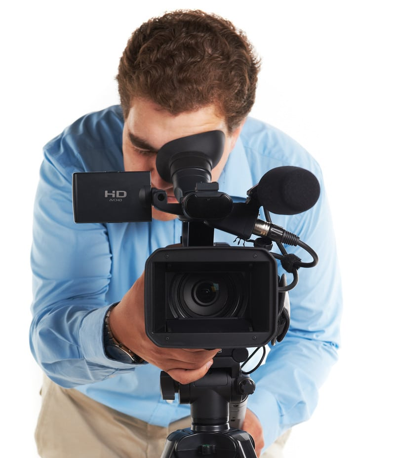 Man looking through eye of video camera